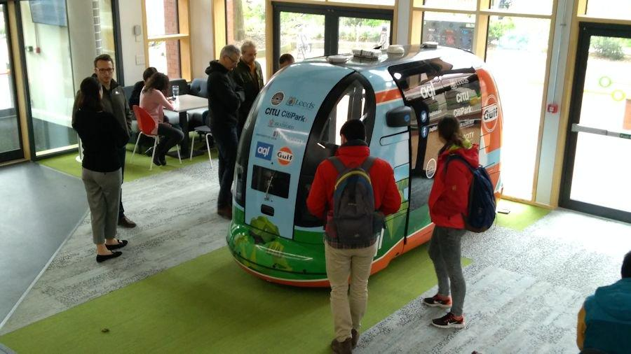 Students and staff at the Institute for Transport Studies at University of Leeds get an up-close look at the driverless POD