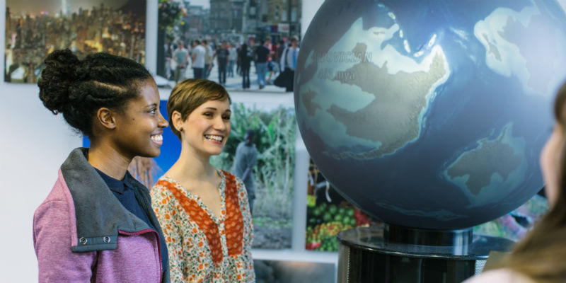 Two University of Leeds students with an interactive globe