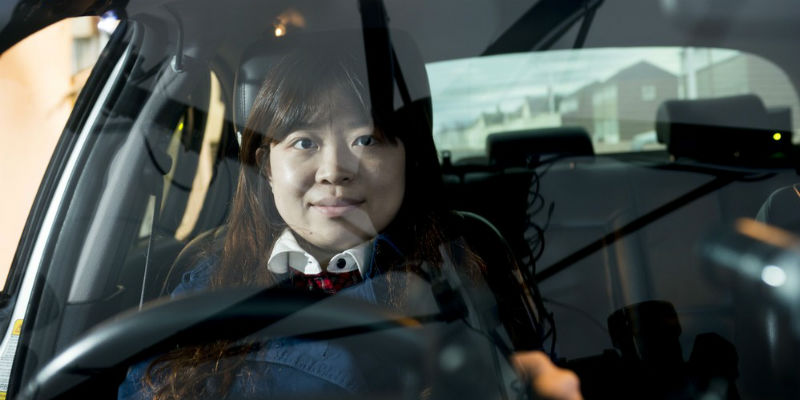 A student sits behind the wheel of our driving simulator at the Institute for Transport Studies in Leeds