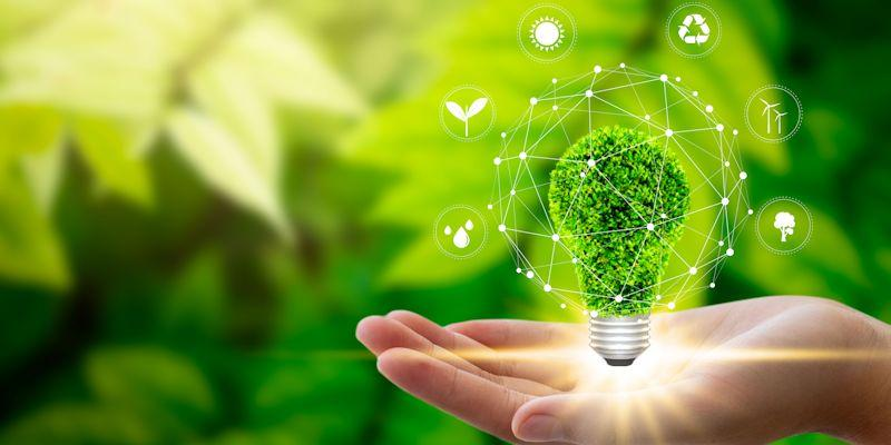 Abstract image with a hand holding light bulb against nature on green leaf with icons energy sources for renewable, sustainable development