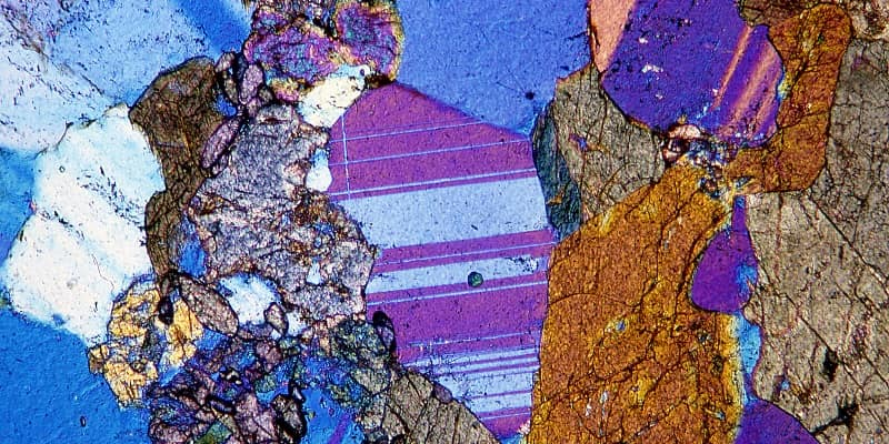 Amphibolite rock thin section through a microscope