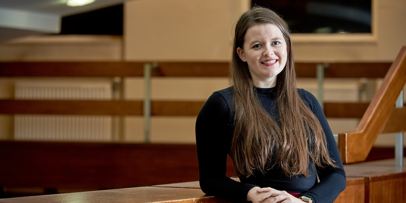 A portrait of a young girl with long brown hair at the University of Leeds