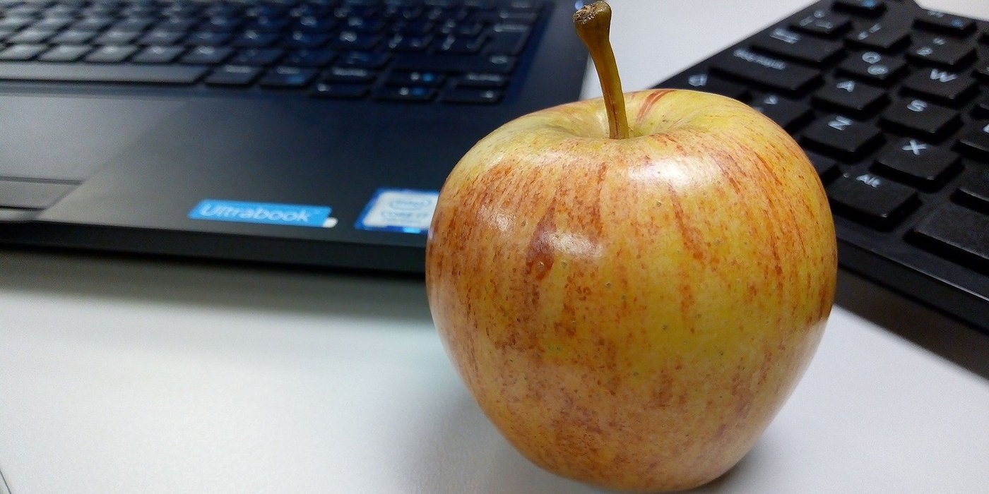 Apple on a working desk
