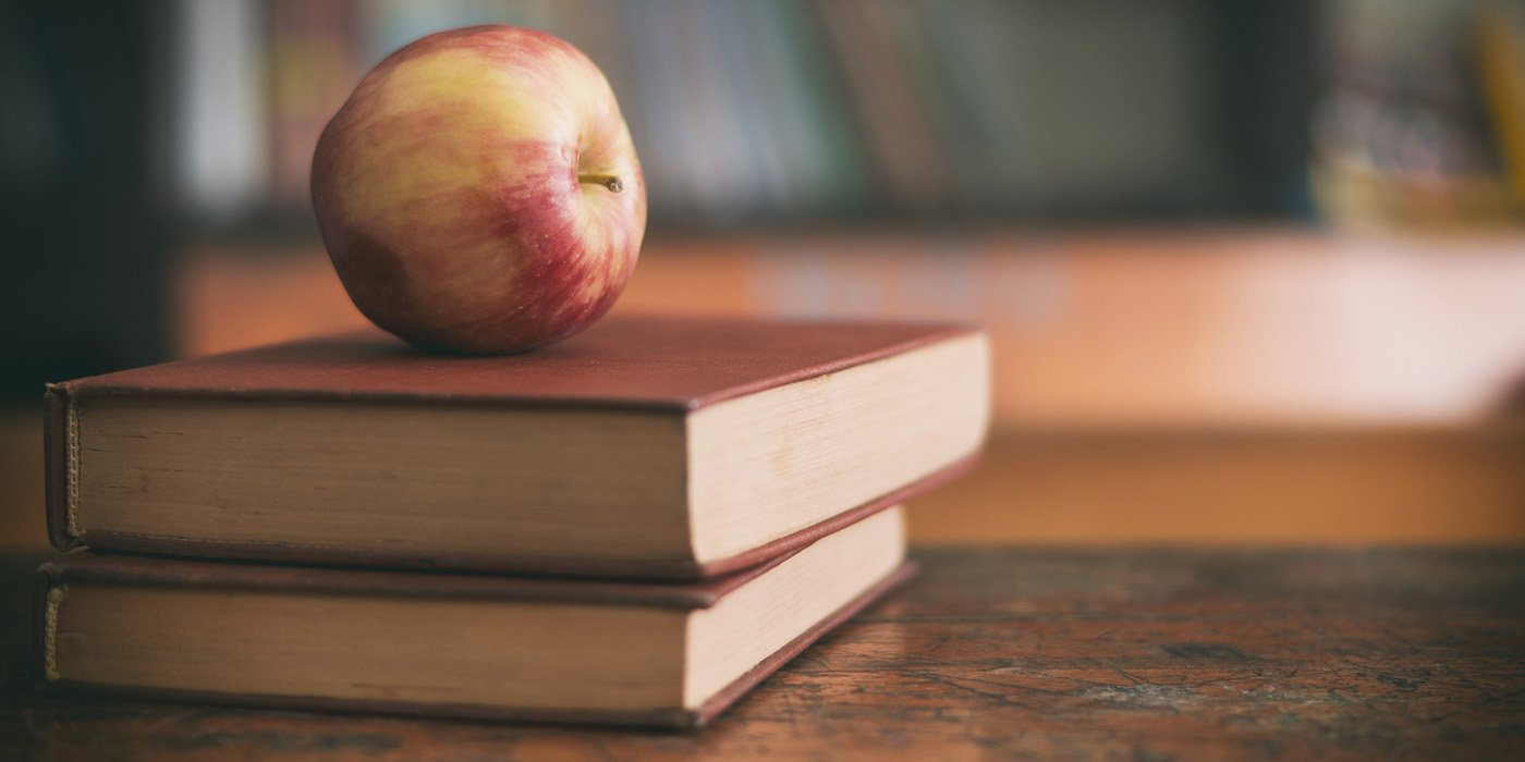 A red apple on two stacked books