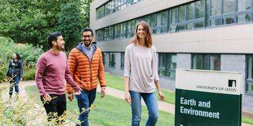 Image of Masters students walking outside the School of Earth and Environment