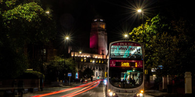 Image of a bus in Leeds city centre at night