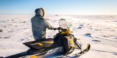 Snowmobile is a common mode of transport in Inuit communities. Temperature influences machine functioning, potential of getting stuck and conditions of ice and snow. Credit: Dylan Clark, McGill University, Canada