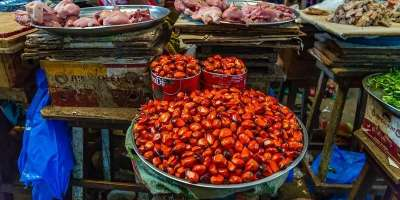 Image of tomatoes at a market