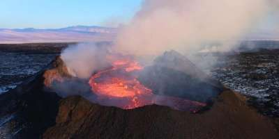 Holuhraun volcano with smoke rising from the top