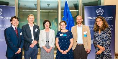 Image of Dr Lucie Middlemiss with White Rose Brussels colleagues