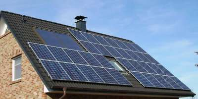 A house roof covered in solar panels.