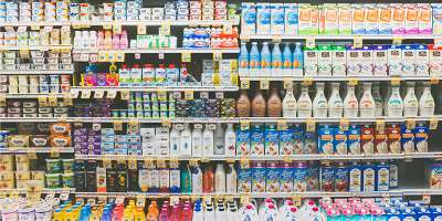 Supermarket aisle showing dairy products