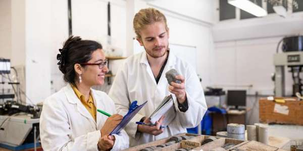 Students working in the rock mechanics lab in the School of Earth and Environment