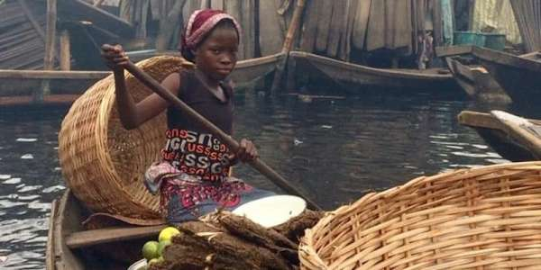 Girl with baskets in boat